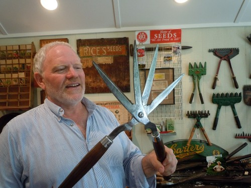 the collector, with a four-bladed hedge pruner