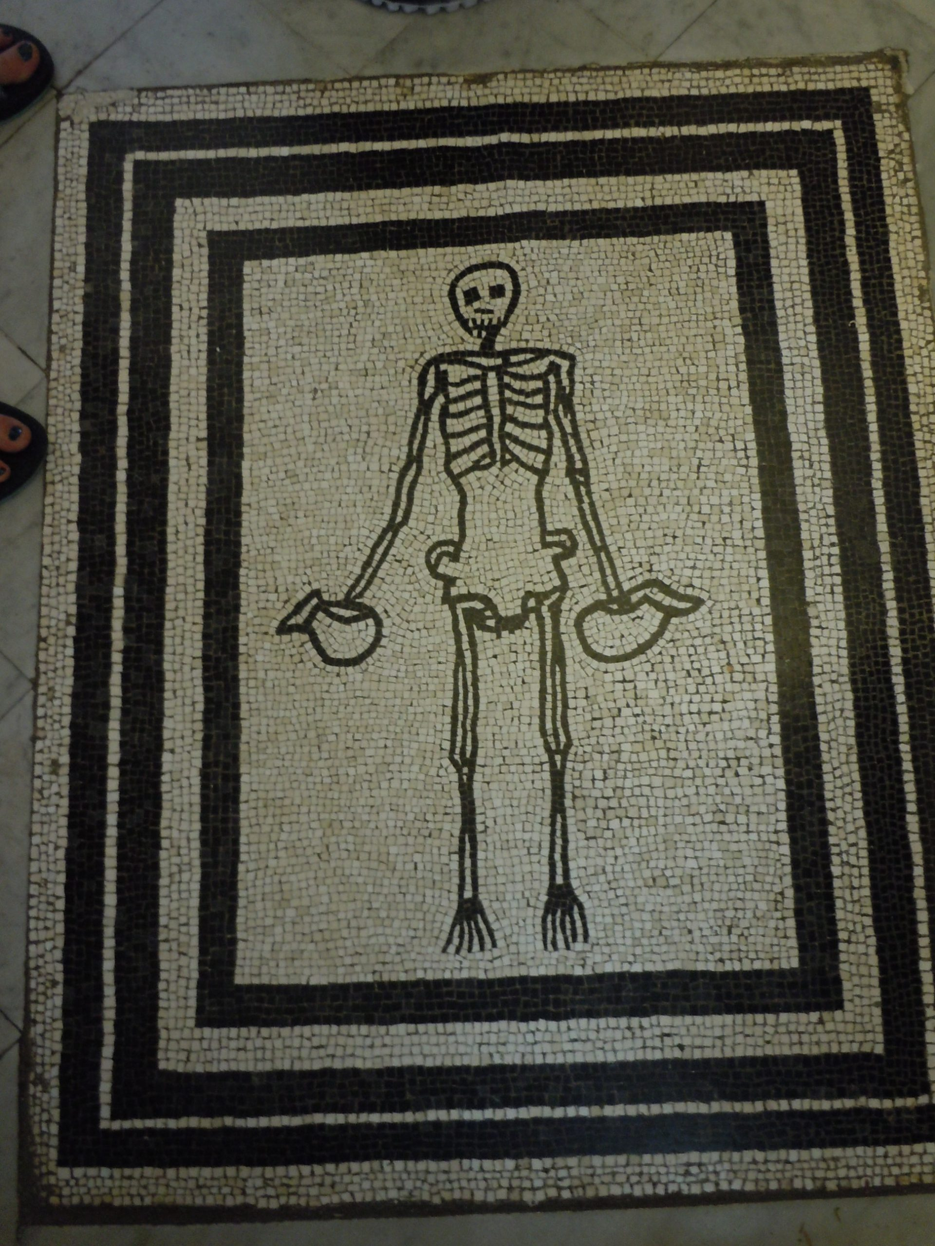 mosaic fro Pompei: enjoy life while you can,  Death is always lurking around the corner