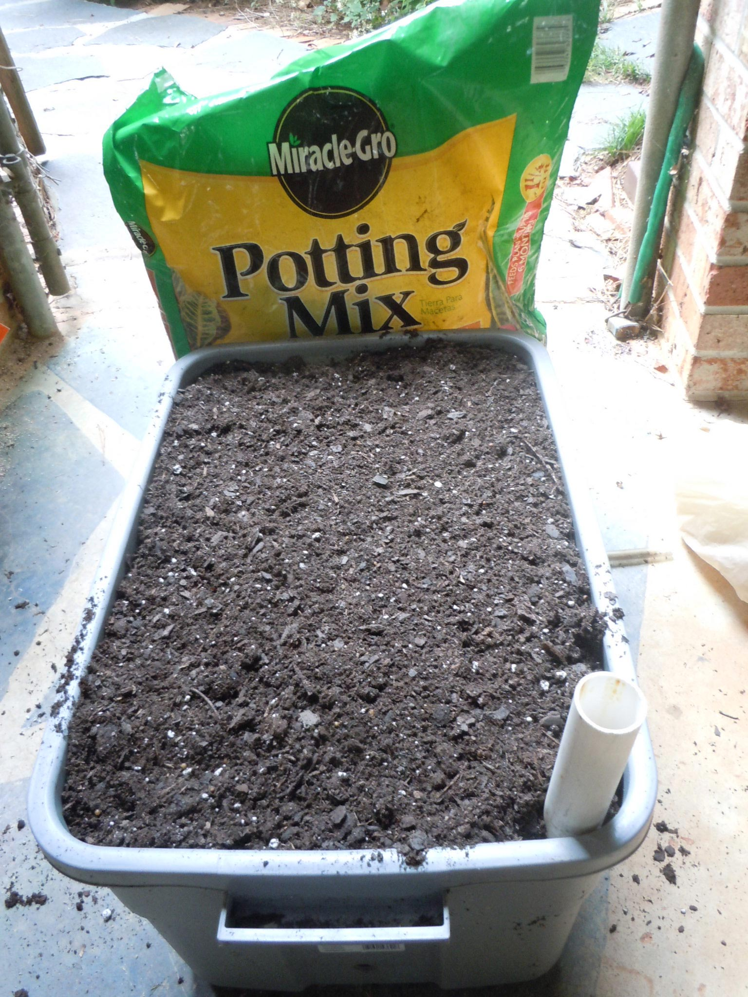 almost there! fill the tub completely with potting soil